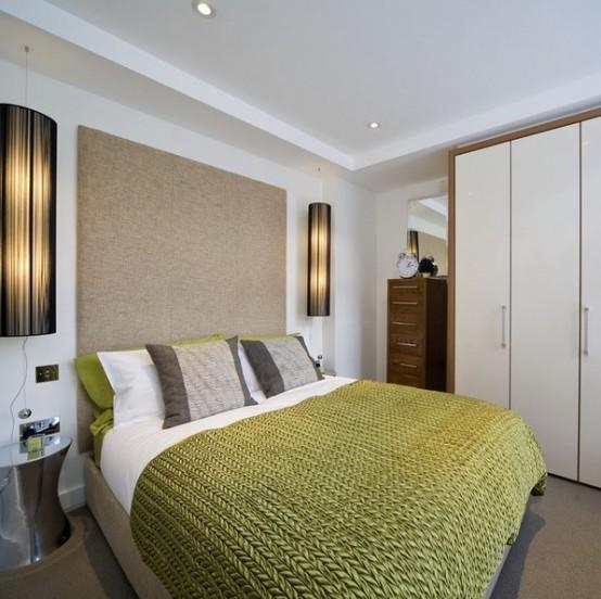 una testiera imbottita sovradimensionata fa sembrare la camera da letto più ampia e accogliente