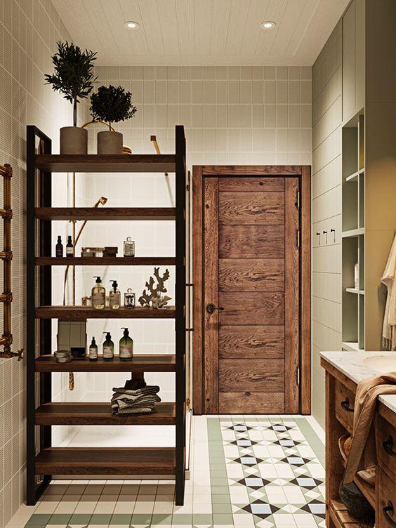 una comoda mensola in legno tinto che divide questo bagno in zone è una cosa molto pratica