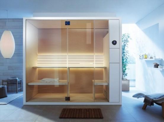 un piccolo bagno turco moderno con legno e metallo, con diverse panche per sedersi e sdraiarsi e luci sul muro