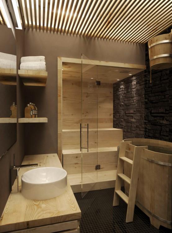 un minuscolo bagno turco completamente rivestito in legno, con panchine e porte in vetro è un'incantevole oasi di relax