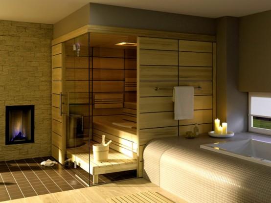 un piccolo bagno turco rivestito di legno chiaro, con panchine e alcune luci incorporate e un focolare è incredibile