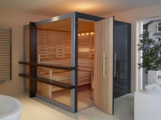 un piccolo bagno turco rivestito in legno naturale e con un'intima illuminazione incorporata per un'atmosfera e un'atmosfera rilassate