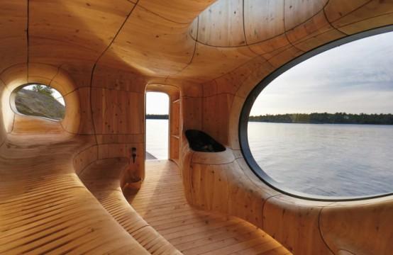 uno splendido bagno turco tutto curvo rivestito in legno, con cavità e diverse finestre e una vista cucire è un'oasi di relax
