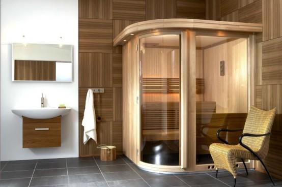 un minuscolo bagno turco rivestito di legno e vetro, con un'unica panca di legno e alcune luci incorporate
