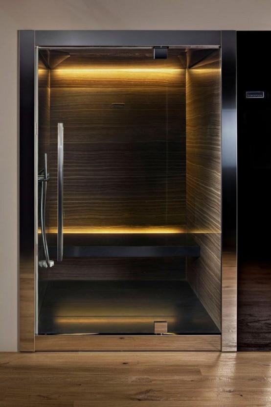 un piccolo bagno turco scuro con pareti in pietra, una panchina galleggiante e luci incorporate è molto rilassante