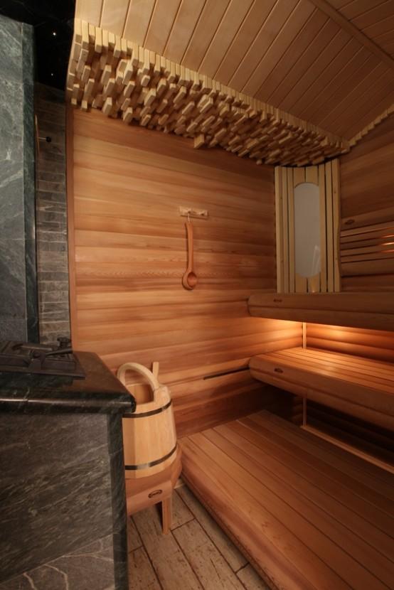 un delizioso bagno turco rivestito in legno con panchine a vari livelli, mattoni in cima e luci incorporate