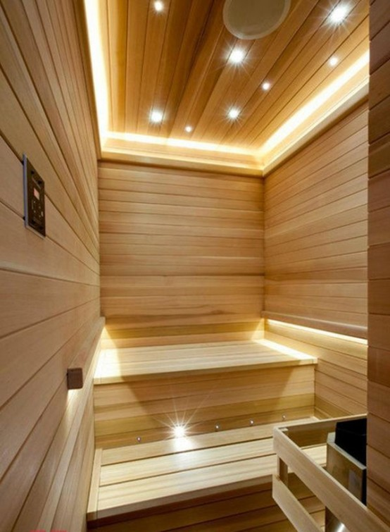 un moderno bagno turco rivestito in legno, con tante luci integrate per rendere lo spazio più accogliente