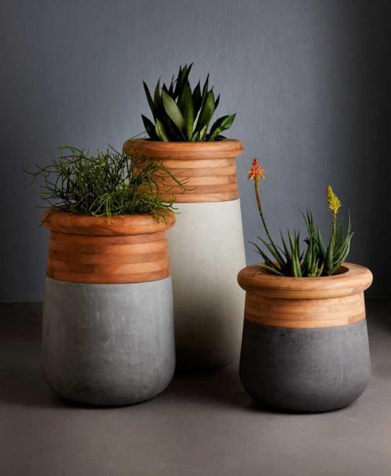eleganti fioriere moderne di cemento e parti in legno presentano forme fresche e molta consistenza