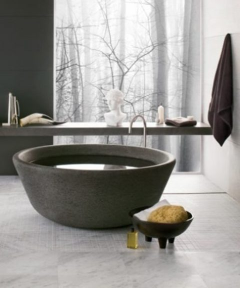 un'esclusiva vasca da bagno in pietra simile a una ciotola è la soluzione definitiva per un bagno contemporaneo o minimalista