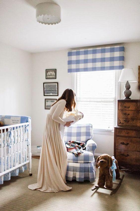 un grazioso cameretta in famiglia con un sacco di plaid blu, un comò macchiato, un tappeto neutro e una culla vintage bianca