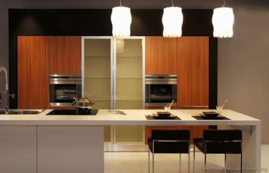 un'isola da cucina minimalista neutra con un piano di lavoro bianco, un fornello, un lavandino e uno spazio per mangiare