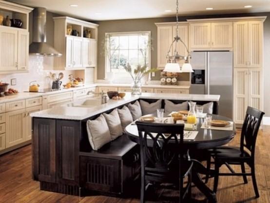 un'isola cucina a forma di L oversize macchiata di scuro con una panca incorporata e controsoffitti bianchi farà risparmiare molto spazio e ti darà tutto ciò di cui hai bisogno