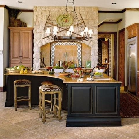un'isola cucina nera oversize e curva con un piano di lavoro in legno è sufficiente per cucinare e mangiare
