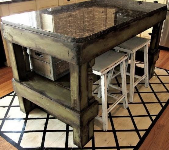 un'isola da cucina squallida in legno tinto scuro con un piano in pietra levigata darà molto spazio per cucinare e persino per mangiare