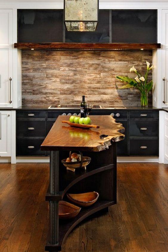 una piccola e stretta isola da cucina in legno tinto scuro con un piano di lavoro con bordo vivo sembra davvero wow