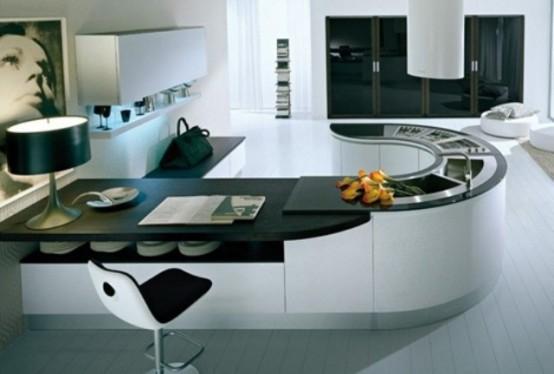 un'isola cucina minimalista di grandi dimensioni in bianco e nero separa la cucina dal resto della casa