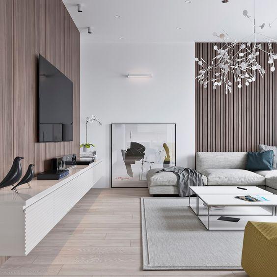 un elegante soggiorno minimal con pannelli in legno, un mobile TV galleggiante, mobili e opere d'arte neutrla laconici