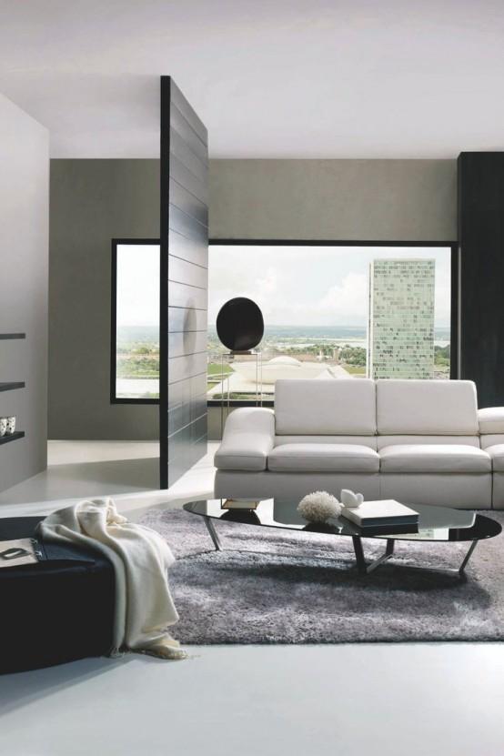 un elegante soggiorno minimal con vista, un divano bianco, mobili neri e un tappeto grigio