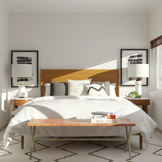 una camera da letto minimal della metà del secolo con opere d'arte monocromatiche, un letto in pelle, comodini in legno curvato, una panca coordinata
