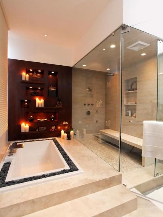 una vasca da bagno incassata della spa circondata da ciottoli e candele accanto sembra davvero rilassante e divertente
