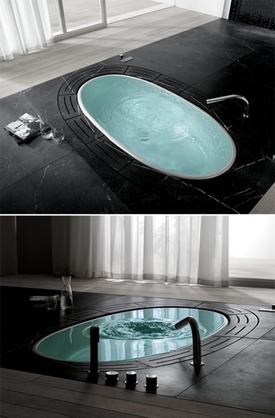 una vasca da bagno incassata integrata nella pietra nera contrasta molto e si distingue per questo