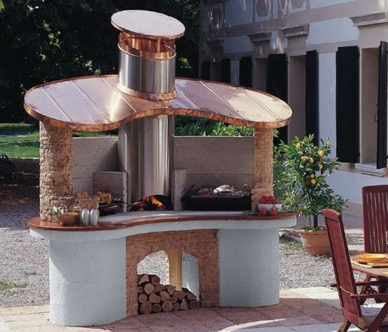 una griglia all'aperto e un forno per la pizza più un po 'di spazio di cottura in un'unica unità per un fresco spazio barbecue all'aperto