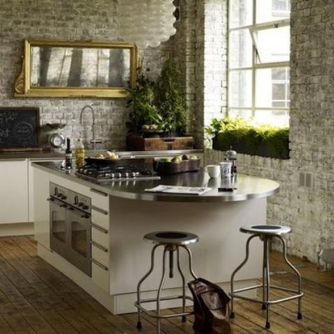 i muri di mattoni imbiancati rendono la cucina meno formale e aggiungono consistenza alle pareti