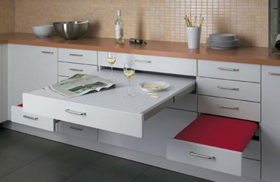 una piccola cucina contemporanea con cassetti che includono un tavolo e sedili che possono essere nascosti in qualsiasi momento