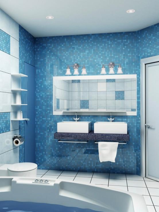 un bagno minimalista con piastrelle a mosaico blu con lavabo in pietra, mobili bianchi e una vasca moderna