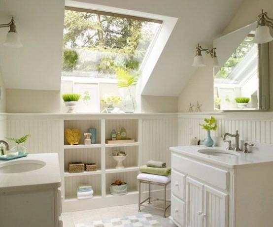 un piccolo bagno in mansarda neutro con ampia finestra, ripostigli in muratura e due lavabo