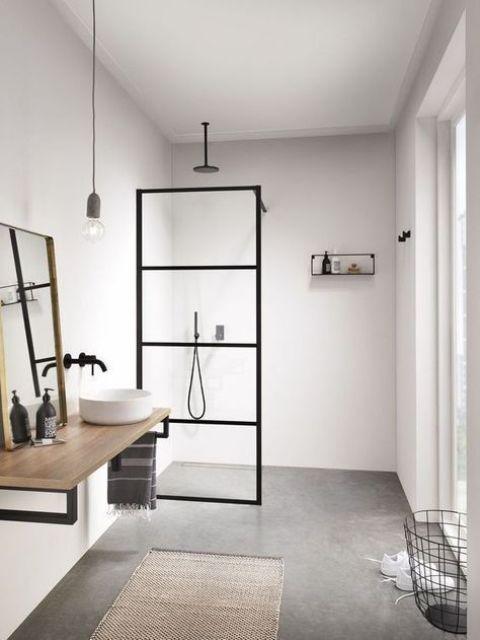 un bagno scandinavo neutro con tocchi neri per il dramma, con legno e un tappeto di iuta più un cesto di filo metallico