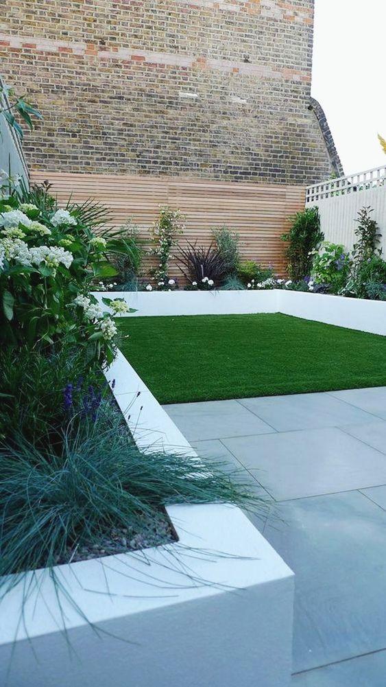 il bordure per aiuole in cemento bianco è un'idea elegante con un tocco minimalista, che accentuerà le tue piante