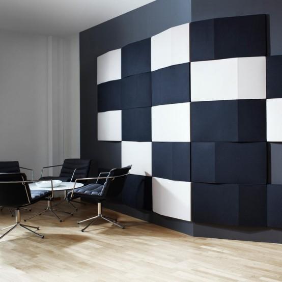 audaci piastrelle rettangolari in bianco e nero creano un'opera d'arte contrastante sul muro
