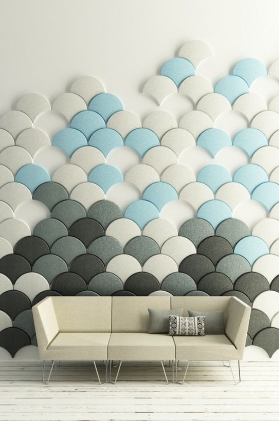pannelli acustici in scala di pesce neutri, grigi e blu accattivanti che compongono un'intera arte murale