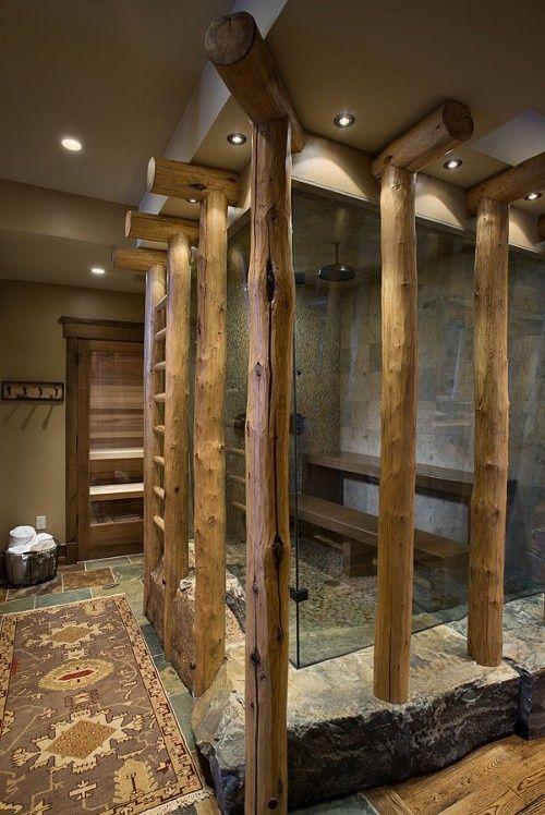 un bagno rustico con doccia in pietra e piastrelle più tronchi che rivestono la doccia