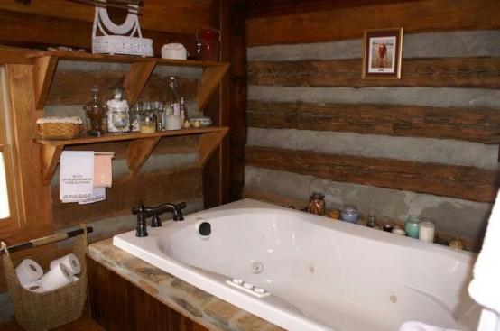 un bagno in legno con qualche pietra sembra rustico e di ispirazione chalet