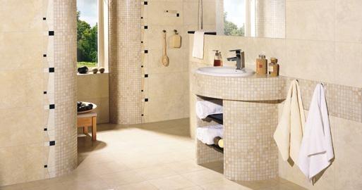 un bagno beige e tortora fatto con piccole piastrelle ed elettrodomestici bianchi