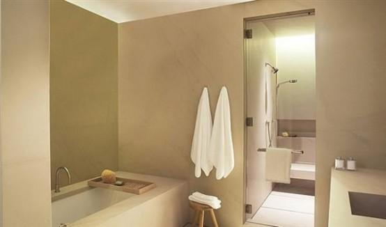 un bagno tortora e bianco con tocchi di tonalità scure sembra molto elegante e contemporaneo
