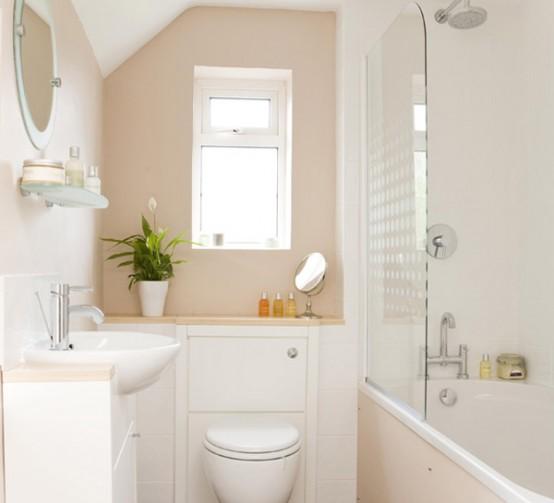 un piccolo bagno tortora e bianco sembra fresco e non sembra così piccolo grazie alla combinazione di colori