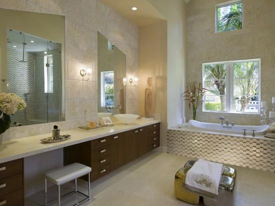 un bagno beige e tortora con una vanità di colore scuro e superfici ed elettrodomestici bianchi