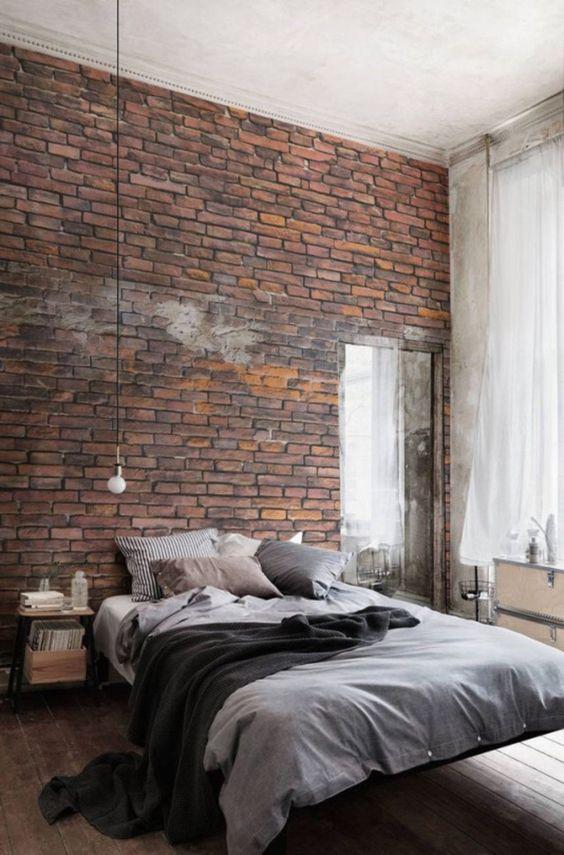 uno splendido muro di mattoni è un'idea straordinaria per una camera da letto maschile o industriale