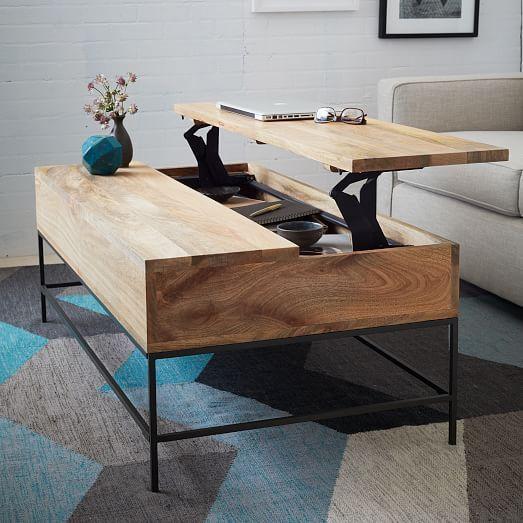 un tavolino da caffè minimalista che può essere facilmente trasformato in una scrivania o in un tavolo da pranzo e dispone di un contenitore