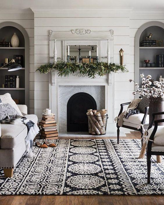 un tappeto a motivi geometrici in bianco e nero completa la stanza e aggiunge un tocco di originalità con texture e motivi