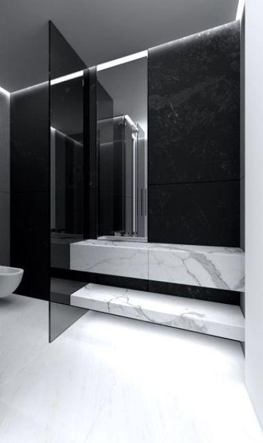 una porta del WC in vetro fumé divide le zone del tuo bagno in modo delicato, sottile, ma allo stesso tempo elegante e spigoloso
