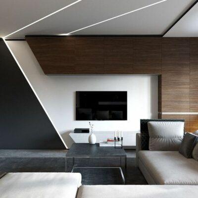un audace soggiorno minimalista con legno tinto scuro, tocchi geometrici, un divano componibile e luci integrate per un'atmosfera futuristica